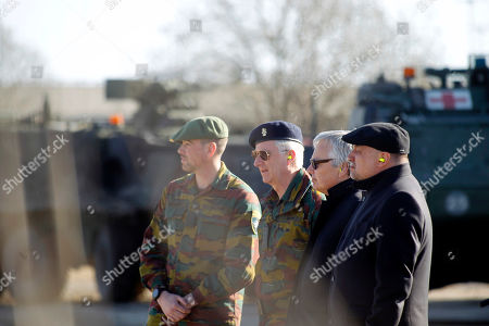 Stock Image of King Philippe of Belgium (2-L), Belgian Foreign and Defense Minister Didier Reynders (2-R) and Estonian Minister of Defence Juri Luik (R) during their visit to Tapa Army Base to meet the Belgian Defense Force soldiers, in Tapa, Estonia, 02 April 2019. Belgium participates in NATO Allied Increased Presence (eFP) missions since 2017. King Philippe is on a one day working visit to Estonia.