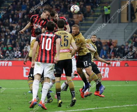 AC Milan's Diego Laxalt, top left, and Alessio Romagnoli jump for the ball during the Serie A soccer match between AC Milan and Udinese, at the San Siro stadium in Milan, Italy