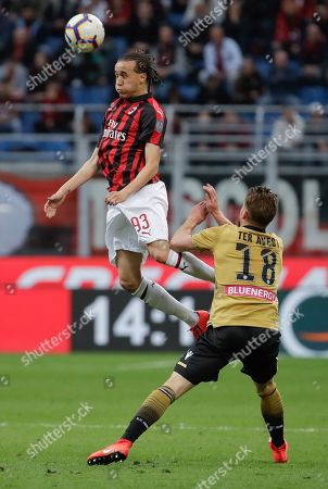 AC Milan's Diego Laxalt heads the ball past Udinese's Hidde Ter Avest during the Serie A soccer match between AC Milan and Udinese, at the San Siro stadium in Milan, Italy