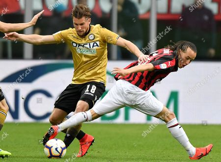 Udinese's Hidde Ter Avest (L) and Milan's Diego Laxalt in action during the Italian Serie A soccer match between AC Milan and Udinese Calcio at the 'Giuseppe Meazza' stadium in Milan, Italy, 02 April 2019.