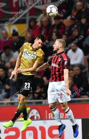 Udinese's Ignacio Pussetto (L) and Milan's Ignazio Abate in action during the Italian Serie A soccer match between AC Milan and Udinese Calcio at the 'Giuseppe Meazza' stadium in Milan, Italy, 02 April 2019.
