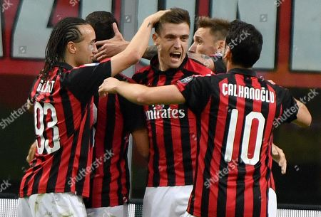 AC Milan's Krzysztof Piatek (C) celebrates with teammates  Diego Laxalt (L) and Hakan Calhanoglu (R) scoring the 1-0 lead during the Italian Serie A soccer match between AC Milan and Udinese Calcio at the 'Giuseppe Meazza' stadium in Milan, Italy, 02 April 2019.