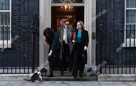 Minister of State for Energy and Clean Growth, Claire Perry (L),  attracts the attenton of Larry the Downing Street cat watched by Secretary of State for Education, Damian Hinds (C) and Secretary of State for Work and Pensions, Amber Rudd (R) as they depart Downing Street following an eight hour cabinet meeting in London, Britain, 02 April 2019. British Prime Minister Theresa May has stated that she will request a short extension from the EU.