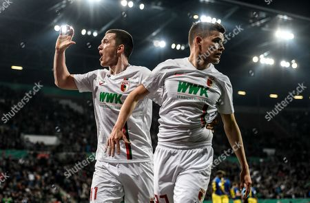 Alfred Finnbogason (R) of Augsburg celebrates with Michael Gregoritsch after scoring the 1-1 during the German DFB Cup quarter final soccer match between FC Augsburg and RB Leipzig in Augsburg, Germany, 02 April 2019