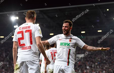 Alfred Finnbogason (L) of Augsburg celebrates with Konstantinos Stafylidis of Augsburg after scoring the 1-1 during the German DFB Cup quarter final soccer match between FC Augsburg and RB Leipzig in Augsburg, Germany, 02 April 2019