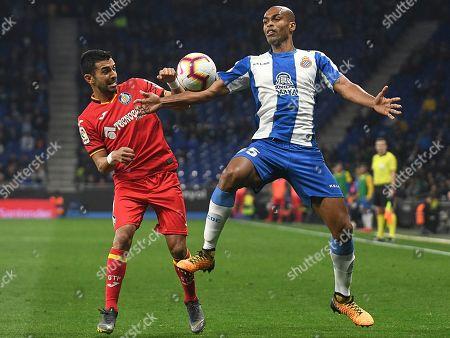 Edinaldo Gomes Naldo of RCD Espanyol and Angel Rodriguez of Getafe CF