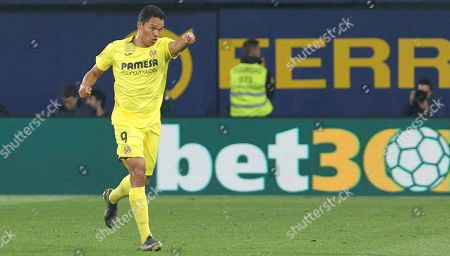 Villarreal's Carlos Bacca celebrates after scoring his side's fourth goal during the Spanish La Liga soccer match between Villarreal and FC Barcelona at the Ceramica stadium in Villarreal, Spain