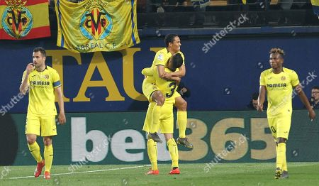 Villarreal's Carlos Bacca, center, celebrates after scoring his side's fourth goal during the Spanish La Liga soccer match between Villarreal and FC Barcelona at the Ceramica stadium in Villarreal, Spain