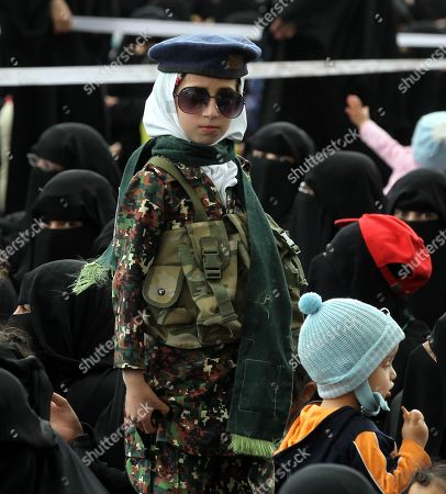 A girl wearing an army uniform and sunglasses stands amongst Houthi female supporters during a rally commemorating the anniversary of the killing of founder of the Houthi movement, Hussein Badreddin al-Houthi, in Sana?a, Yemen, 02 April 2019. The founder of the Houthi movement, Hussein al-Houthi was killed in the 2004 conflict between the Shiite Houthi fighters and the former regime of president Ali Abdullah Saleh. The Houthis could take control on the northern province of Saada in 2011 after an uprising broke out against slain president Saleh. In September 2014, they took over the capital Sana?a and other parts of the country.