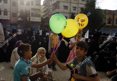 Children hold balloons during a rally commemorating the anniversary of the killing of founder of the Houthi movement, Hussein Badreddin al-Houthi, in Sana?a, Yemen, 02 April 2019. The founder of the Houthi movement, Hussein al-Houthi was killed in the 2004 conflict between the Shiite Houthi fighters and the former regime of president Ali Abdullah Saleh. The Houthis could take control on the northern province of Saada in 2011 after an uprising broke out against slain president Saleh. In September 2014, they took over the capital Sana?a and other parts of the country.