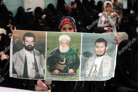 A Houthi female supporter holds a banner depicting portraits (R-L) of the Houthi movement's leader Abdul-Malik al-Houthi, his father and the movement?s slain founder Hussein Badreddin al-Houthi, during a rally commemorating the anniversary of the killing of Hussein, in Sana?a, Yemen, 02 April 2019. The founder of the Houthi movement, Hussein al-Houthi was killed in the 2004 conflict between the Shiite Houthi fighters and the former regime of president Ali Abdullah Saleh. The Houthis could take control on the northern province of Saada in 2011 after an uprising broke out against slain president Saleh. In September 2014, they took over the capital Sana?a and other parts of the country.