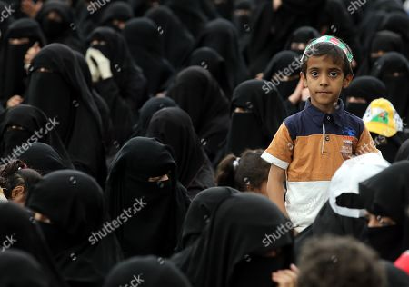 A Yemeni boy stands amongst Houthi female supporters attending a rally commemorating the anniversary of the killing of founder of the Houthi movement, Hussein Badreddin al-Houthi, in Sana?a, Yemen, 02 April 2019. The founder of the Houthi movement, Hussein al-Houthi was killed in the 2004 conflict between the Shiite Houthi fighters and the former regime of president Ali Abdullah Saleh. The Houthis could take control on the northern province of Saada in 2011 after an uprising broke out against slain president Saleh. In September 2014, they took over the capital Sana?a and other parts of the country.