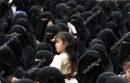 A Yemeni girl stands amongst Houthi female supporters attending a rally commemorating the anniversary of the killing of founder of the Houthi movement, Hussein Badreddin al-Houthi, in Sana?a, Yemen, 02 April 2019. The founder of the Houthi movement, Hussein al-Houthi was killed in the 2004 conflict between the Shiite Houthi fighters and the former regime of president Ali Abdullah Saleh. The Houthis could take control on the northern province of Saada in 2011 after an uprising broke out against slain president Saleh. In September 2014, they took over the capital Sana?a and other parts of the country.