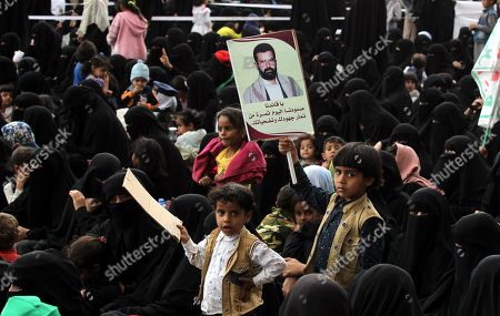 A boy holds a banner depicting portrait of the Houthi movement's slain founder Hussein Badreddin al-Houthi, during a rally commemorating the anniversary of his killing, in Sana?a, Yemen, 02 April 2019. The founder of the Houthi movement, Hussein al-Houthi was killed in the 2004 conflict between the Shiite Houthi fighters and the former regime of president Ali Abdullah Saleh. The Houthis could take control on the northern province of Saada in 2011 after an uprising broke out against slain president Saleh. In September 2014, they took over the capital Sana?a and other parts of the country.