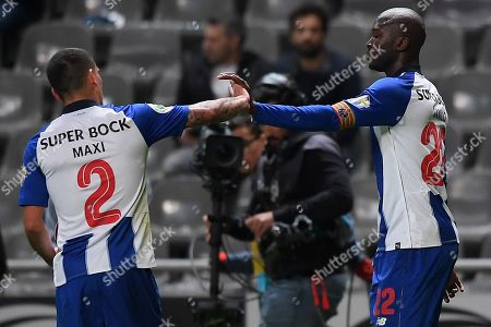 Stock Image of FC Porto's Danilo (R) celebrates with his teammate Maxi Pereira (L) after scoring during their Portuguese Cup soccer second leg match held at Braga Municipal Stadium, Braga, Portugal, 2 April 2019.