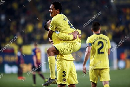 Villarreal's Colombian striker Carlos Bacca (C) celebrates with Alvaro Gonzalez (L) after scoring the fourth goal during a Spanish LaLiga soccer match between Villarreal CF and FC Barcelona played at the Ceramica Stadium in Villarreal, eastern Spain, 02 April 2019.