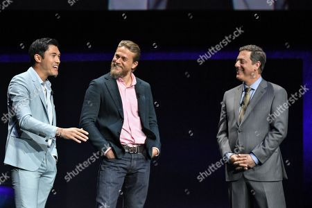 Henry Golding, Charlie Hunnam and Adam Fogelson