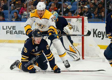 Buffalo Sabres defenseman Rasmus Dahlin (26) is checked by Nashville Predators forward Brian Boyle (11) during the second period of an NHL hockey game, in Buffalo, N.Y