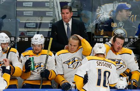 Stock Photo of Nashville Predators head coach Peter Laviolette looks on during the first period of an NHL hockey game against the Buffalo Sabres, in Buffalo, N.Y