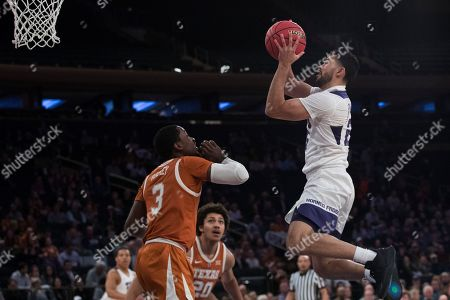 Alex Robinson, Courtney Ramey. TCU guard Alex Robinson, right, goes to the basket against Texas guard Courtney Ramey, left, during the first half of a semifinal college basketball game in the National Invitational Tournament, at Madison Square Garden in New York