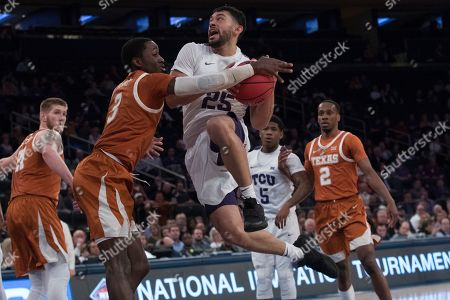 Alex Robinson, Courtney Ramey. TCU guard Alex Robinson (25) goes to the basket against Texas guard Courtney Ramey (3) during the first half of a semifinal college basketball game in the National Invitational Tournament, at Madison Square Garden in New York