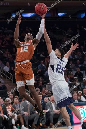 Kerwin Roach II, Alex Robinson. Texas guard Kerwin Roach II (12) goes to the basket past TCU guard Alex Robinson (25) during the second half of a semifinal college basketball game in the National Invitational Tournament, at Madison Square Garden in New York. Texas won 58-44