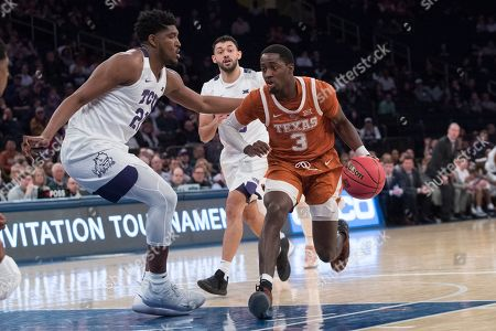 Kevin Samuel, Courtney Ramey. Texas guard Courtney Ramey (3) drives to the basket against TCU center Kevin Samuel (21) during the second half of a semifinal college basketball game in the National Invitational Tournament, at Madison Square Garden in New York. Texas won 58-44