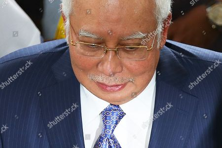 Former Malaysian Prime Minister Najib Tun Razak arrives at the Kuala Lumpur High Court in Kuala Lumpur, Malaysia. Razak is facing seven charges in the first of several criminal proceedings over the suspected money laundering of 4.5 billion US dollar from state fund 1Malaysia Development Berhad (1MDB).