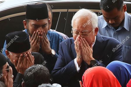 Former Malaysian Prime Minister Najib Tun Razak (2-R) arrives at the Kuala Lumpur High Court in Kuala Lumpur, Malaysia. Razak is facing seven charges in the first of several criminal proceedings over the suspected money laundering of 4.5 billion US dollar from state fund 1Malaysia Development Berhad (1MDB).