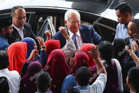 Stock Photo of Former Malaysian Prime Minister Najib Tun Razak (C, top) arrives at the Kuala Lumpur High Court in Kuala Lumpur, Malaysia. Razak is facing seven charges in the first of several criminal proceedings over the suspected money laundering of 4.5 billion US dollar from state fund 1Malaysia Development Berhad (1MDB).