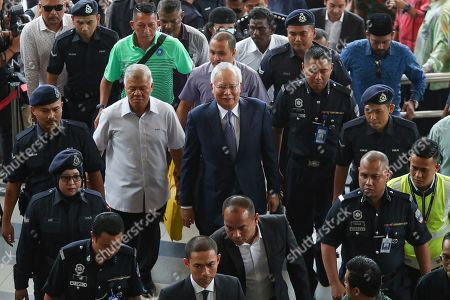 Stock Image of Former Malaysian Prime Minister Najib Tun Razak (C) arrives at the Kuala Lumpur High Court in Kuala Lumpur, Malaysia. Razak is facing seven charges in the first of several criminal proceedings over the suspected money laundering of 4.5 billion US dollar from state fund 1Malaysia Development Berhad (1MDB).