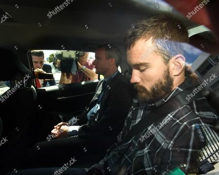 Stock Image of Bobby Andrew Weaver (R) leaves the Tweed Heads Police Station with Queensland Police in a vehicle at Tweed Heads, New South Wales, Australia, 03 April 2019. Queensland Police have been granted permission by the Tweed Heads Magistrate to extradite Bobby Andrew Weaver back to Queensland in relation to the alleged murder of David Thornton, whose body was found in a freezer buried in his backyard.