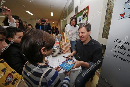 Stock Image of 'Diary of a Wimpy Kid' author Jeff Kinney visits the Vittorio Veneto school in Scampia, Naples