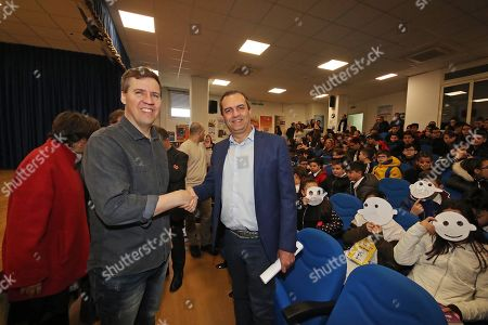 Stock Picture of 'Diary of a Wimpy Kid' author Jeff Kinney visits the Vittorio Veneto school in Scampia, Naples