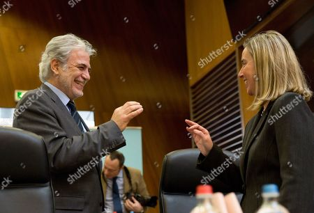 European Commissioner for Humanitarian Aid Christos Stylianides, left, speaks with European Union foreign policy chief Federica Mogherini during a meeting of the College of Commissioners at EU headquarters in Brussels, . With Britain racing toward a chaotic exit from the European Union within days, Prime Minister Theresa May veered away from the cliff-edge Tuesday, saying she would seek another Brexit delay and hold talks with the opposition to seek a compromise
