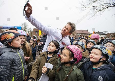 Edwin van der Sar (C), general manager of Ajax Amsterdam football club, distributes bicycle helmets in a school yard in Doetinchem, the Netherlands, 03 April 2019. Thirty thousand schoolchildren received a helmet from the Edwin van der Sar Foundation and the Dutch organization for traffic and tourism ANWB, to reduce try and reduce the number of road casualties.