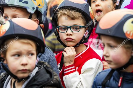 Childeren wear helmets that were distributed by Edwin van der Sar (C), general manager of Ajax Amsterdam football club, in a school yard in Doetinchem, the Netherlands, 03 April 2019. Thirty thousand schoolchildren received a helmet from the Edwin van der Sar Foundation and the Dutch organization for traffic and tourism ANWB, to reduce try and reduce the number of road casualties.