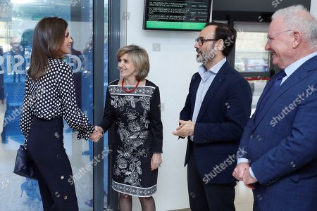 Queen Letizia of Spain (L) greets Spanish Health Minister Maria Luisa Carcedo (2-L), President of Efe news agency, Fernando Garea (2-R) and president of Mental Health Spain Nel A. Gonzalez (R) before the start of a forum about the language used by media to talk about mental health and the importance of words when talking about this issue.