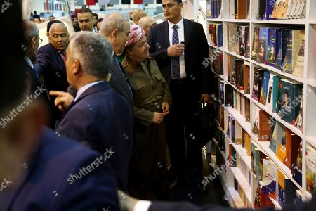 Former president of the Kurdistan Region the head of the Kurdistan Democratic Party Masoud Barzani (C-R) and Iraqi politician Ayad Allawi (C-L) look at books displayed during the opening ceremony of the 14th Erbil International Book Fair in Erbil, the capital of the Kurdistan Region, Iraq, 03 April 2019. According to the organizers, around 300 exhibitors from over 20 countries are taking part in the fair running till 13 April. Organizers has reportedly banned books that are said to promote extremist ideology.
