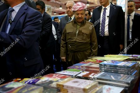 Former president of the Kurdistan Region the head of the Kurdistan Democratic Party Masoud Barzani (C, front) and Iraqi politician Ayad Allawi (C, back) look at books displayed during the opening ceremony of the 14th Erbil International Book Fair in Erbil, the capital of the Kurdistan Region, Iraq, 03 April 2019. According to the organizers, around 300 exhibitors from over 20 countries are taking part in the fair running till 13 April. Organizers has reportedly banned books that are said to promote extremist ideology.