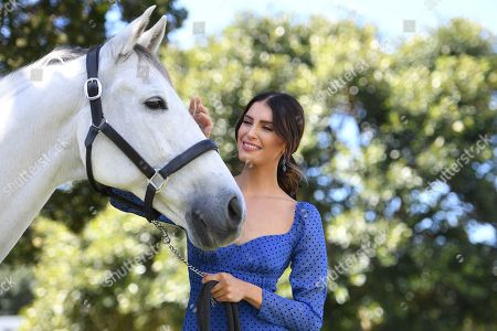 Erin Holland poses for a photograph with horse Mojo at a lunch hosted by the Australian Turf Club, at Centennial Parklands in Sydney, Australia, 03 April 2019.