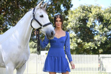 Stock Picture of Erin Holland poses for a photograph with horse Mojo at a lunch hosted by the Australian Turf Club, at Centennial Parklands in Sydney, Australia, 03 April 2019.
