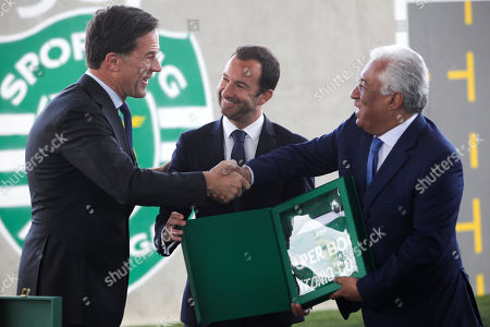 Dutch's Prime Minister Mark Rutte (L) shake hands with  by Portugal's Prime Minister Antonio Costa (R) after receiving a jersey from Sporting's President Frederico Varandas (C) during their visit to Sporting's soccer Academy in Alcochete, Portugal, 03 April 2019.