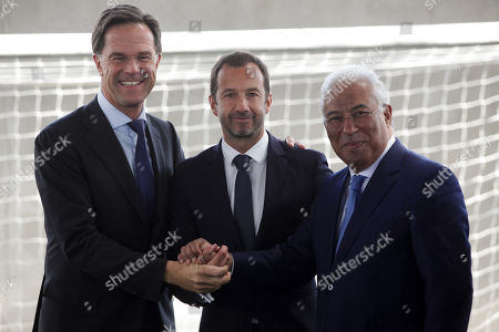 Dutch's Prime Minister Mark Rutte (L) flanked by Portugal's Prime Minister Antonio Costa (R) and Sporting's President Frederico Varandas (C) shake hands during their visit to Sporting's soccer Academy in Alcochete, Portugal, 03 April 2019.