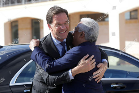 Dutch's Prime Minister Mark Rutte (L) is greeted by Portugal's Prime Minister Antonio Costa (R) as he arrives to visit the Sporting's soccer Academy in Alcochete, Portugal, 03 April 2019.