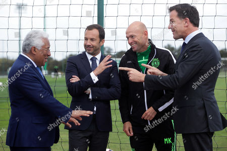 Dutch's Prime Minister Mark Rutte (R) and Portugal's Prime Minister Antonio Costa (L) speak with Sporting's President Frederico Varandas (2-L) and head coach Marcel Keizer (2-R) during their visit to Sporting's soccer Academy in Alcochete, Portugal, 03 April 2019.