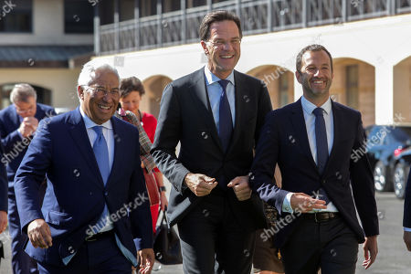 Dutch's Prime Minister Mark Rutte (C) flanked by Portugal's Prime Minister Antonio Costa (L) and Sporting's President Frederico Varandas (R) during their visit to Sporting's soccer Academy in Alcochete, Portugal, 03 April 2019.