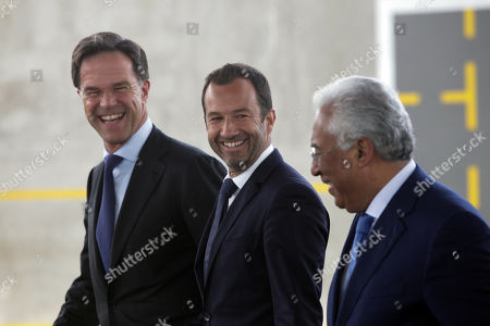 Dutch's Prime Minister Mark Rutte (L) flanked by Portugal's Prime Minister Antonio Costa (R) and Sporting's President Frederico Varandas (C) during their visit to Sporting's soccer Academy in Alcochete, Portugal, 03 April 2019.