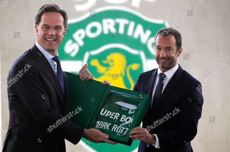 Dutch's Prime Minister Mark Rutte (L) receives a jersey from Sporting's President Frederico Varandas (R) during his visit to Sporting's soccer Academy in Alcochete, Portugal, 03 April 2019.