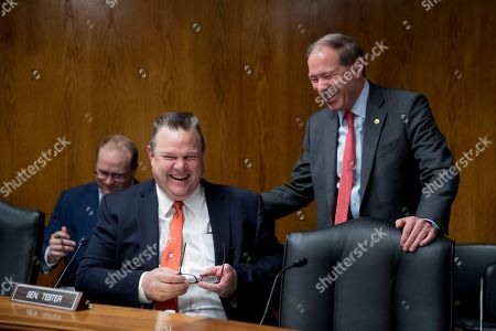 Sen. Jon Tester, D-Mont., left, and Sen. Tom Udall, D-N.M., right, share a laugh together before Environmental Protection Agency Administrator Andrew Wheeler arrives to testify at a Senate Appropriations subcommittee on budget on Capitol Hill in Washington